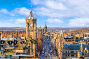 Edinburgh Princes Street from Calton Hill with views of Balmoral Clock tower, shops and spires