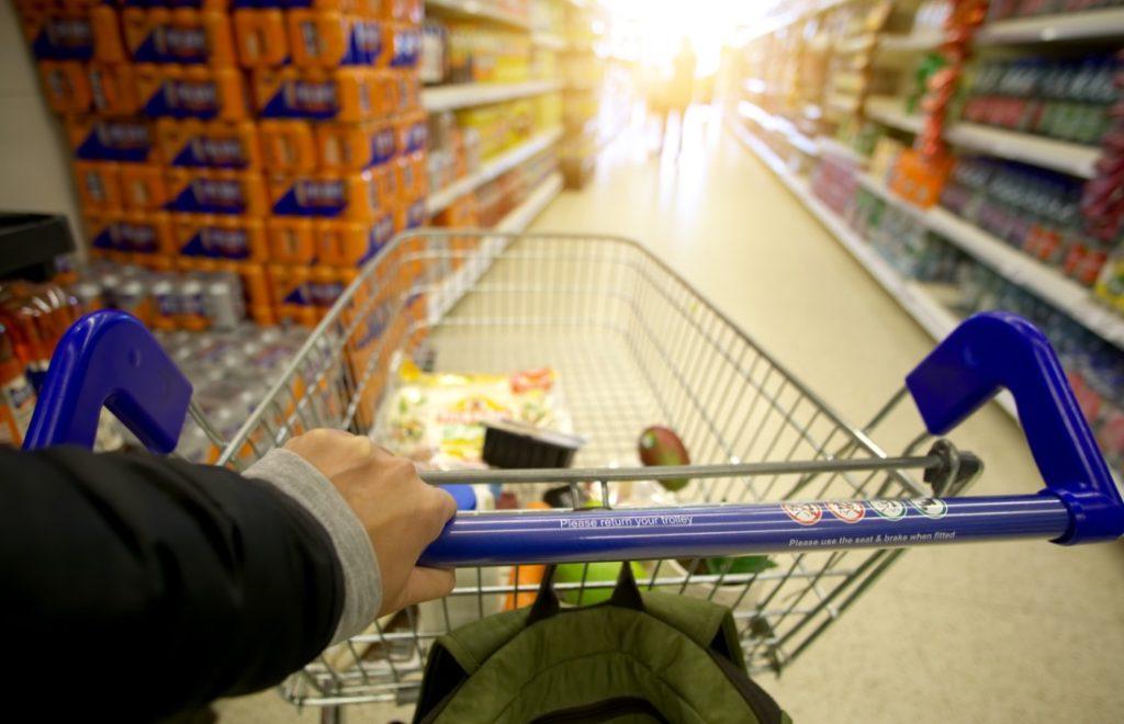 Edinburgh. shopping trolley full of groceries along a supermarket aisle. Irn bru. Food