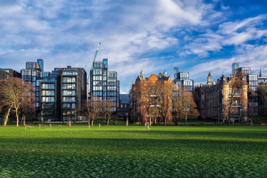 Edinburgh's skyline with the Meadows (Park) in the foreground. Scotland, United Kingdom