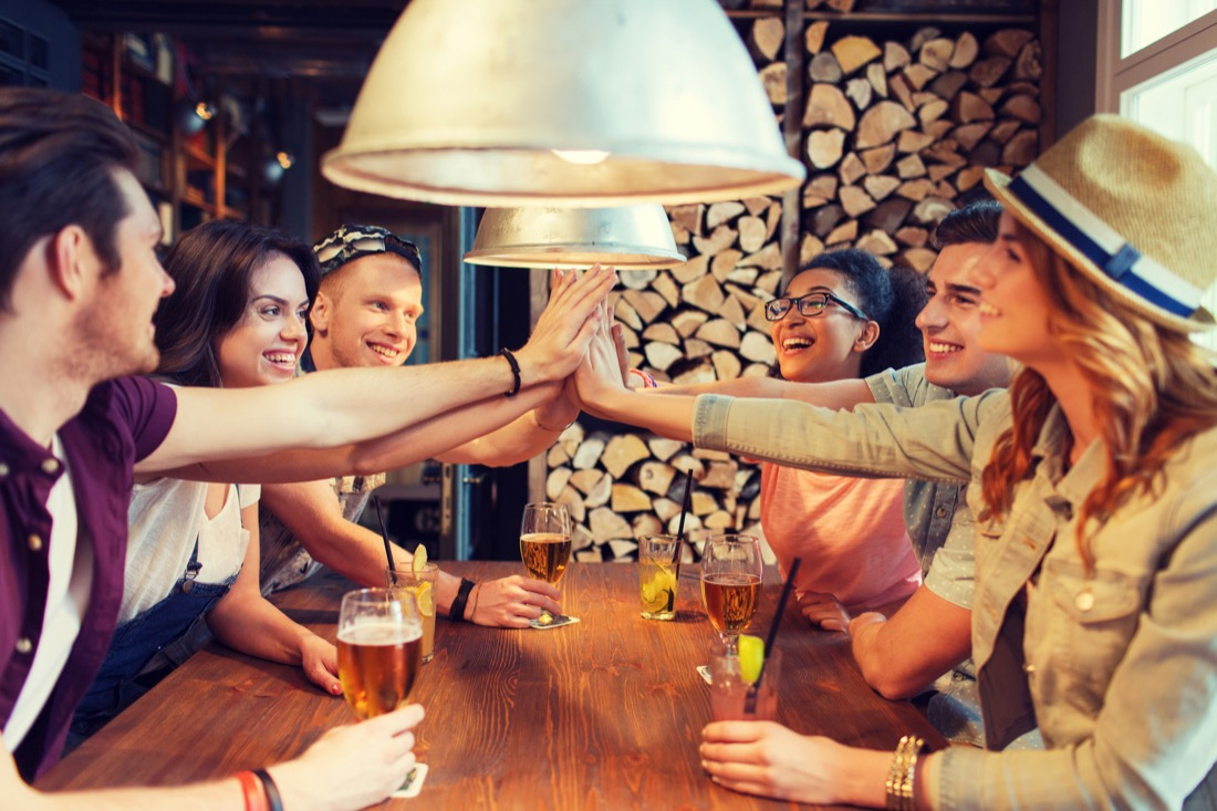 Group of Friends in a Pub with Drinks High Five Edinburgh
