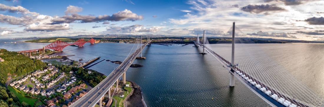 Queensferry Crossing bridge (on the right) over the Firth of Forth with the older Forth Road bridge (on the left) and with the iconic Forth Rail Bridge. Edinburgh. Transport