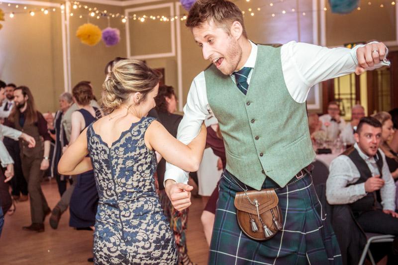Scottish couple at ceilidh men in kilts