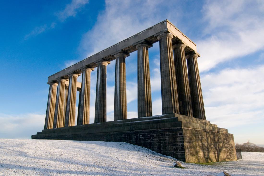 The National Monument on Calton Hill in winter, Edinburgh, Scotland. Snow. Christmas.