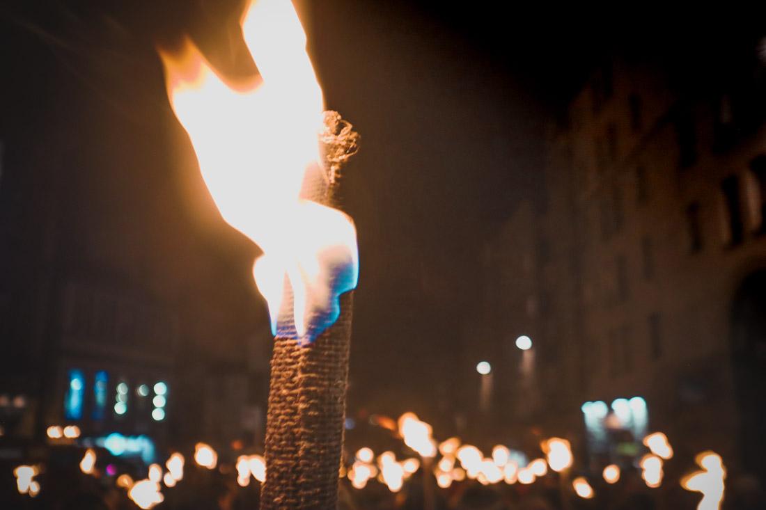 Torch Lit at Torchlight Procession Edinburgh Festival Royal Mile_
