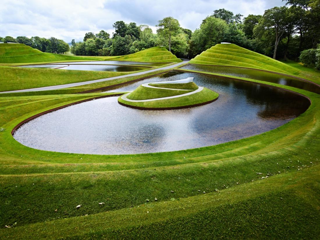 Water and green grass slopes art Cells of Life Charles Jencks Credit Jupiter Artland garden nature