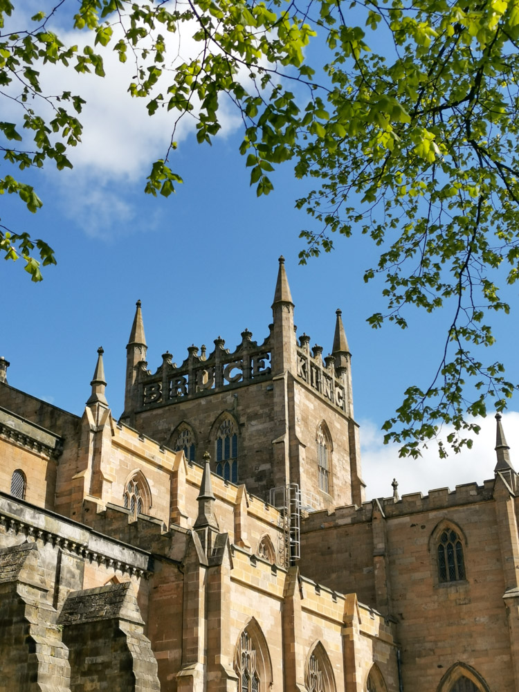 Dunfermline Abbey Fife, blue skies, King Bruce engraved into tower