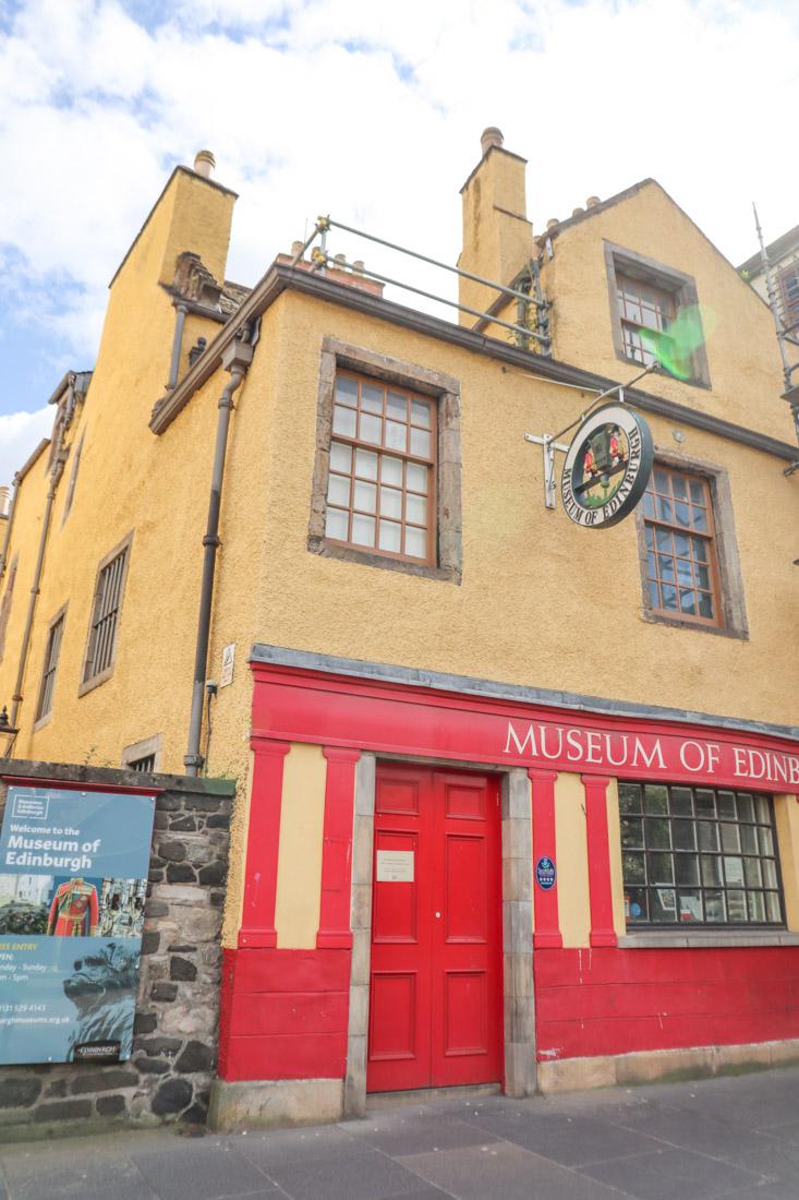 Yellow building, red doors of Museum of Edinburgh Royal Mile Edinburgh