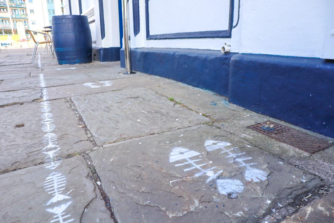 2 metres social distance markings on floor leith pub