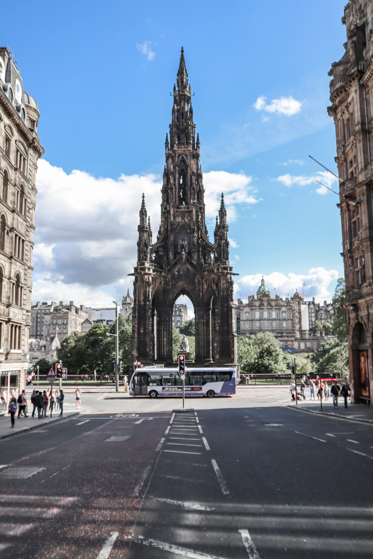 A Lothian Bus driving in front of the Scott Monument
