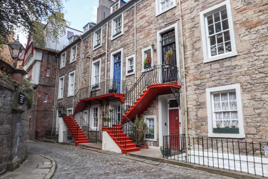 Red doors and staircases of Ramsay Lane Old Town Edinburgh