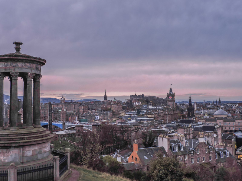 Calton Hill Edinburgh with purple sunset looking over New Town buildings