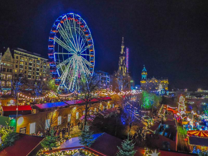 Edinburgh's Christmas Market at night with Christmas lights
