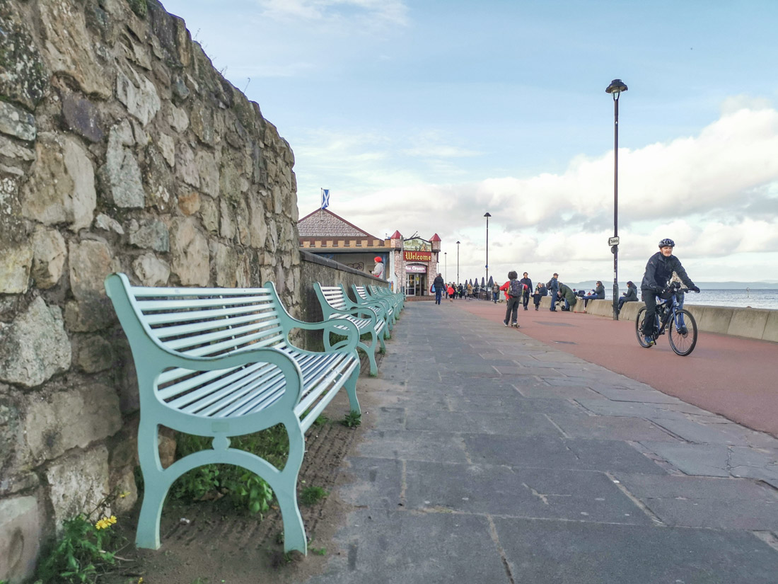 Portobello Beach bench with cyclist