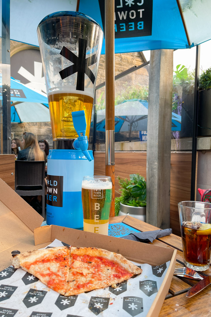 Pizza, beer on Cold Town House Edinburgh rooftop table