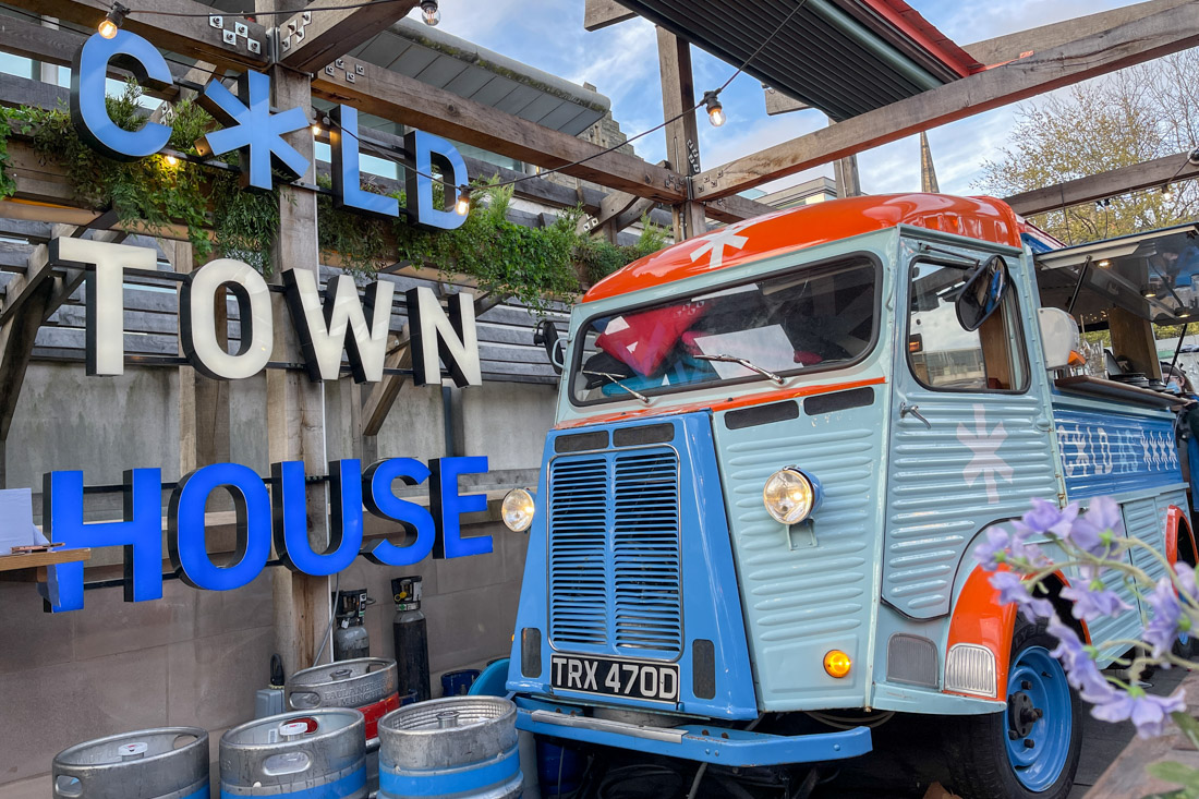Cold Town House rooftop sign and caravan bar