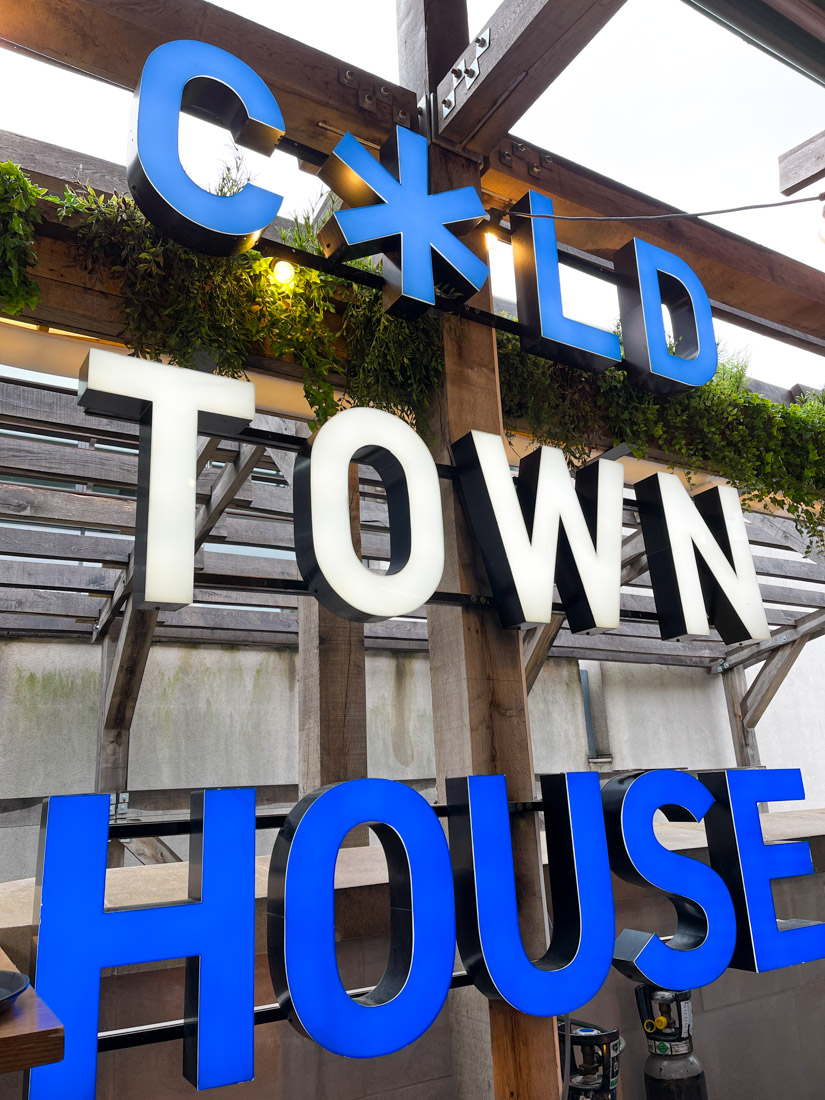 Blue and white Cold Town House sign