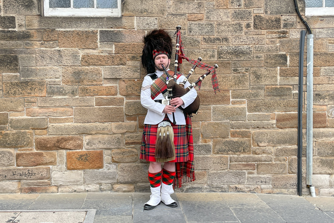 A piper playing on the Royal Mile